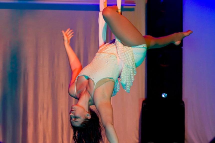 Disabled aerial acrobat Lauren Watson hangs upside down