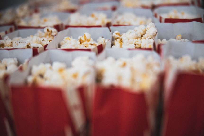 Popped corn in a red container.