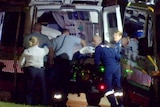 Paramedics try to resuscitate a man who was stabbed multiple times.