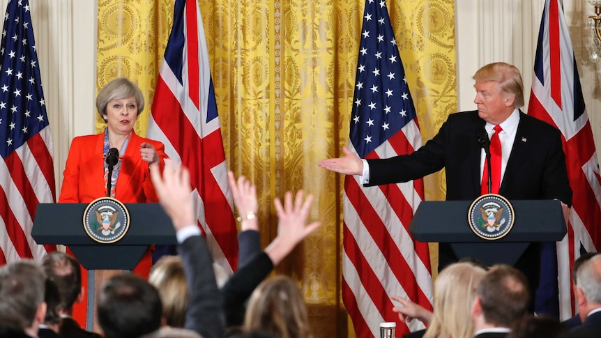 Theresa May unequivocal on Russia sanctions but Trump says it's 'very early' to be discussing