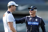 Carlton assistant coach John Barker (L) chats with coach Mick Malthouse at training in May 2013.