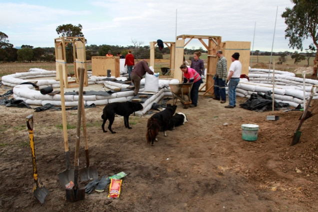 Volunteers gather to help build the Kendenup earth bag home
