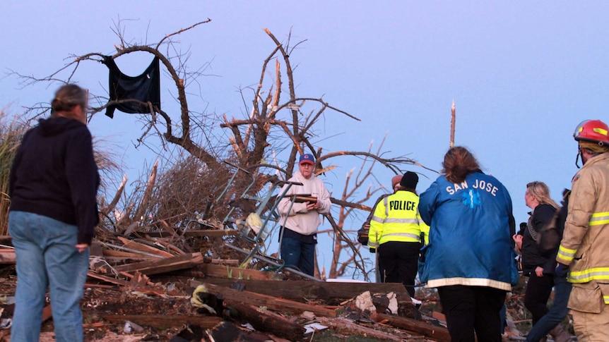 Residents of Elgin Avenue sort through debris after a tornado struck in Washington, Illinois.