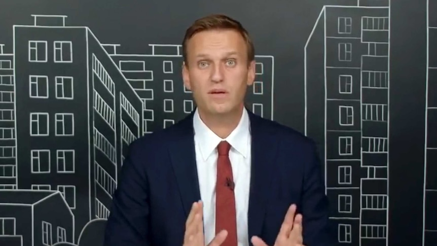 A man in the middle of making a speech