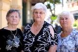 Rose Kruger, Philomena Hall and Patricia Wenman standing shoulder to shoulder on Fremantle street