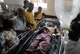 Soldier wounded during battle with Tamil Tiger rebels receives medical treatment as family members w
