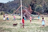 Residents of the Mandala commune in northern New South Wales dance around a maypole