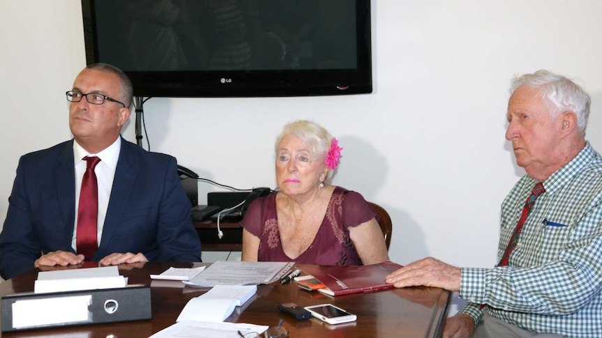 Lawyer John Hammond sits with clients Marye Louise Daniels and Ron McLean