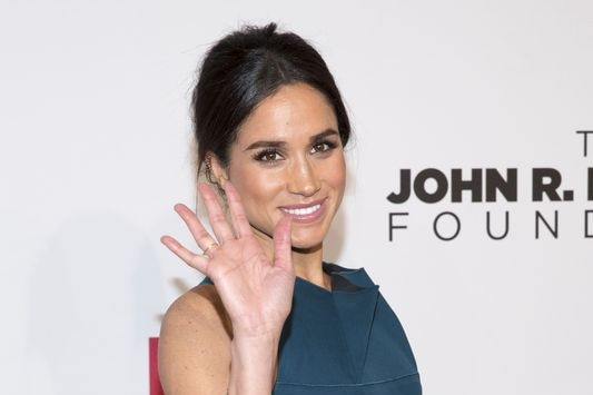 Meghan Markle waves to cameras