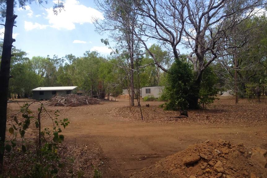 Bushland and donga housing.