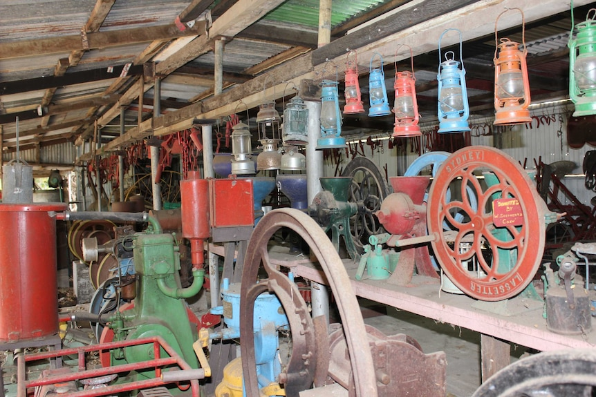 Old, dusty and colourful farming machinery in a shed