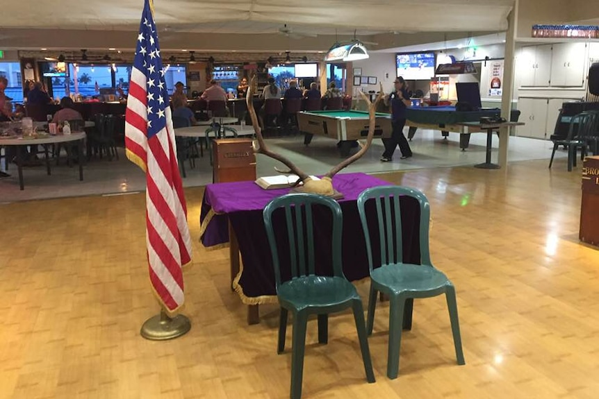Two empty chairs at the Kona Elks Lodge, Hawaii, placed as a memorial to two chopper crash victims in the Whitsundays