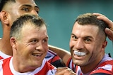 Daniel Tupou, Josh Morris, James Tedesco and Angus Crichton of the Sydney Roosters celebrate a try in their NRL clash with Manly