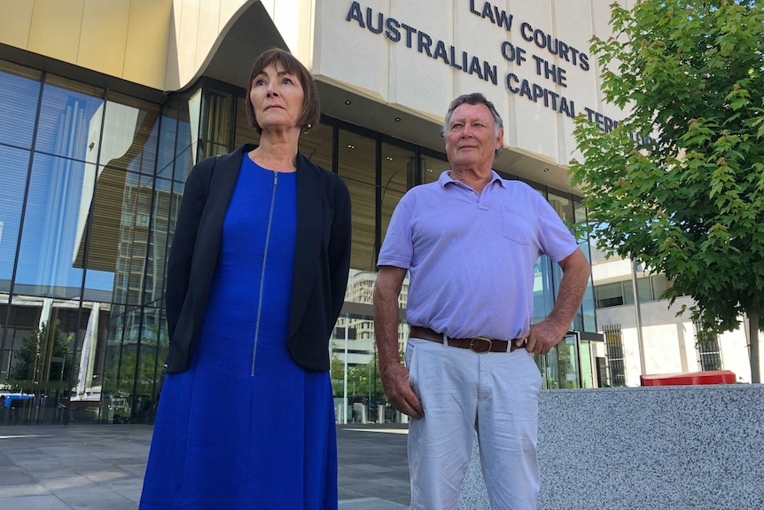 A couple stands outside the ACT courts building.