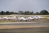A number of small aircraft parked.