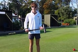 Young croquet player Edward Wilson with mallet in hand.