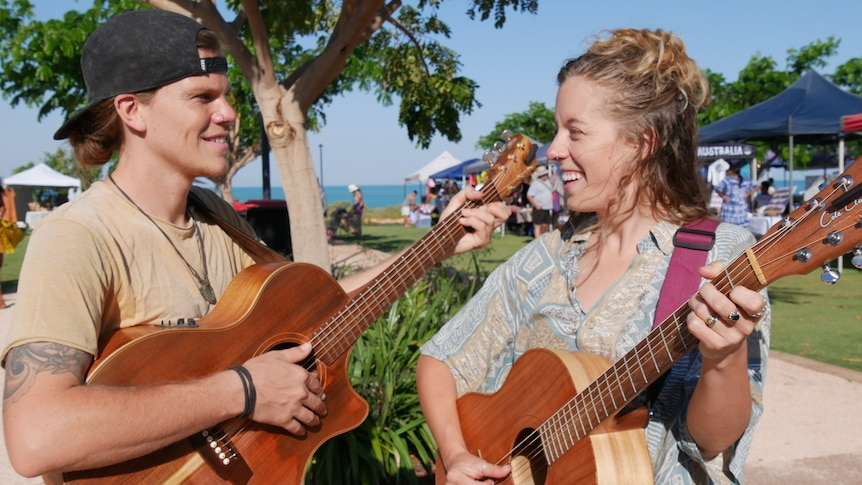 Laura Kirkup and Tyson Richardson play guitar at the markets
