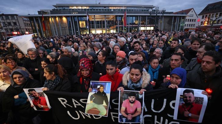Dozens attend a vigil for the victims of a shooting in Hanau, near Frankfurt, Germany.