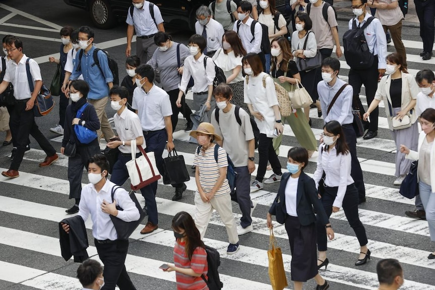 Crowd of people wearing facemasks in Osaka after COVID-19 state of emergency