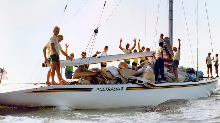 The crew of America's Cup yacht Australia II cheer.