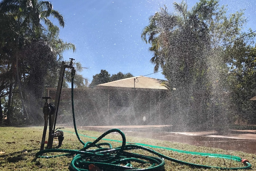A sprinkler spraying water into the air.