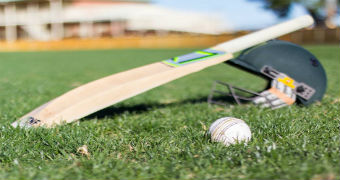 Picture of a cricket bat, ball and hat