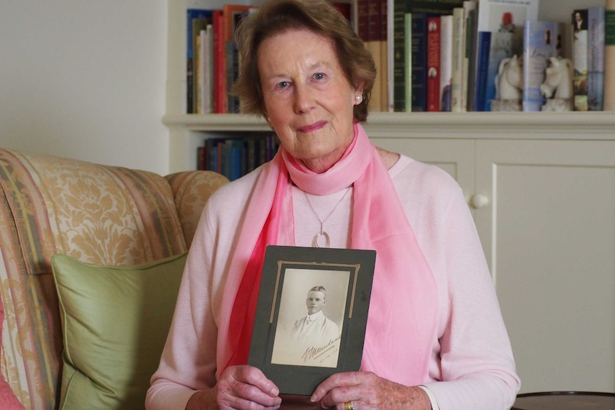 Leonie Matheson holds a photo of her grandfather, Victor Newland.