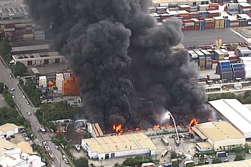 An aerial view of a large warehouse fire