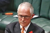 Malcolm Turnbull crosses his arms in parliament