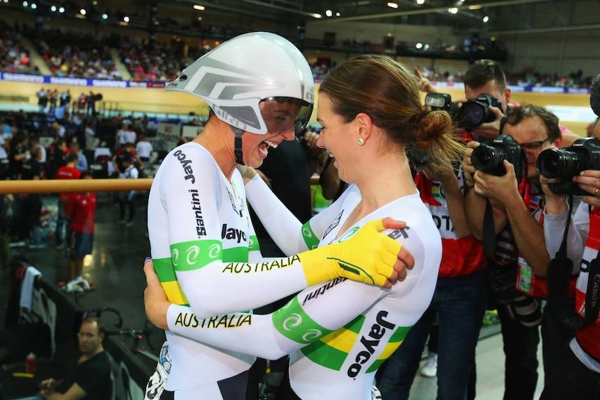 Rebecca Wiasak (left) celebrates winning gold