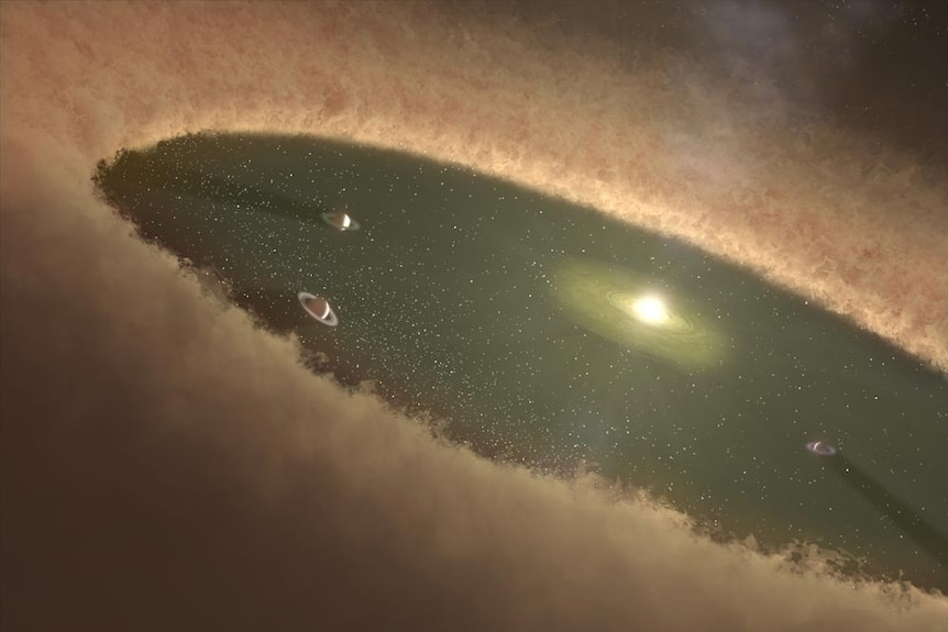 Large disk of dust and gas surrounding a young star with a central region of the disk cleared out by newly forming planets.