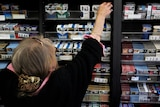 Cigarette companies will be forced to adopt no-frills packaging under new Federal Government laws.
