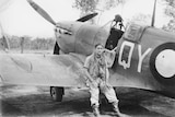 Flight Sergeant Colin Duncan sits in front of his plane, which crashed at Litchfield National Park in 1943.