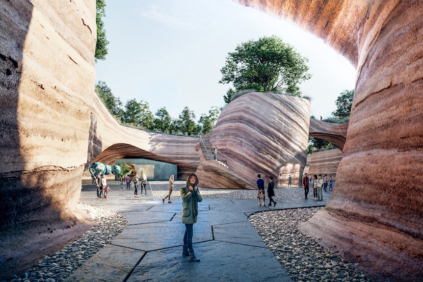 An artist's impression of the Eden Project's plan showing a person in a winter coat staring up at a red rock formation.