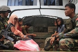 Philippine soldiers guarding members of the Maute extremist group