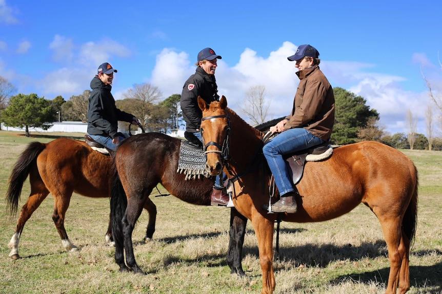 Three men on horses