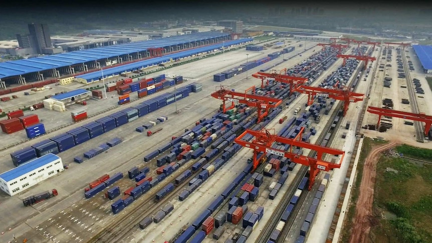 Chongqing City Logistics Center, showing rows of shipping containers and the cranes for moving them on trains.