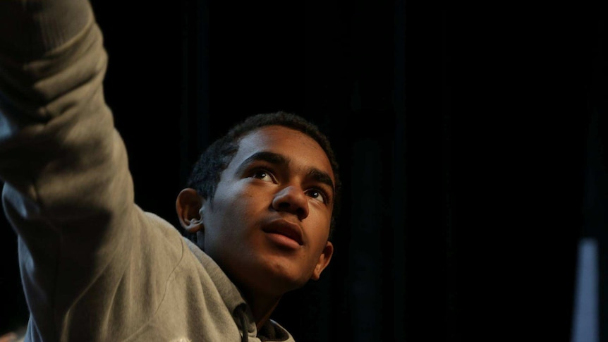 A boy acting on stage