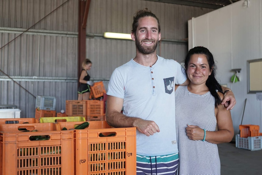 two backpackers in packing shed