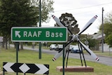 A sign pointing to the RAAF Base