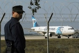 A policeman stands guard at Larnaca Airport near a hijacked Egyptair A320.