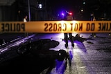 Two suspects lie dead on the street of Adriatico, Manila after failing to stop at a police checkpoint.
