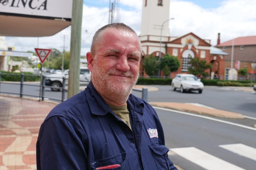 A man smiling in the main street of Stanthorpe.