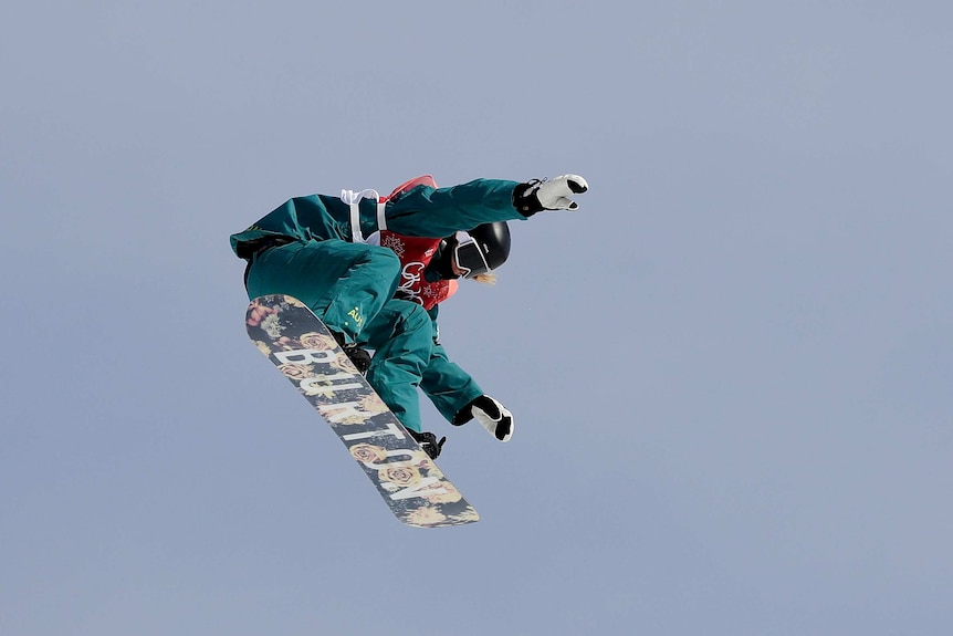 Jessica Rich jumps during big air snowboard qualifying