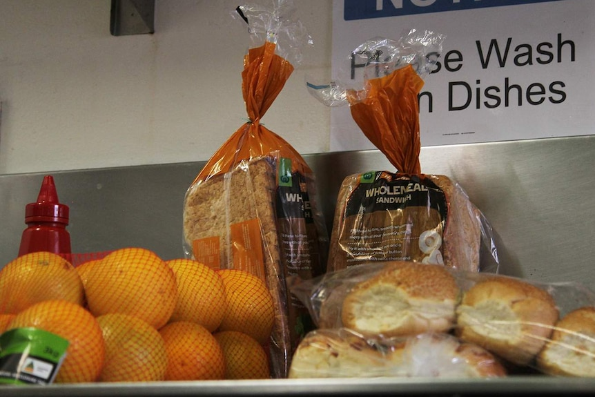 A photo of some bags of bread and other food items on a kitchen counter.