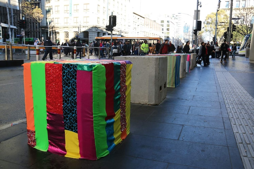 Striped bollard cover adorns one of the 200 concrete security bollards recently put in place in Melbourne's CBD.