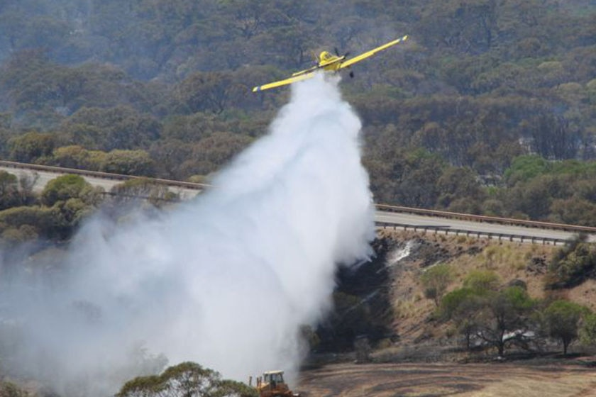 A waterbomber assists in a bushfire