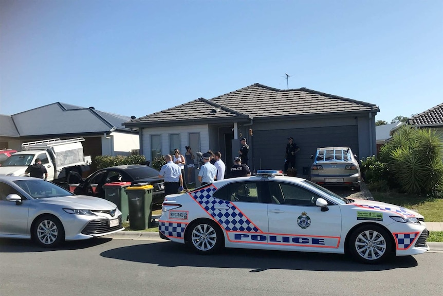 Police cars outside a home.