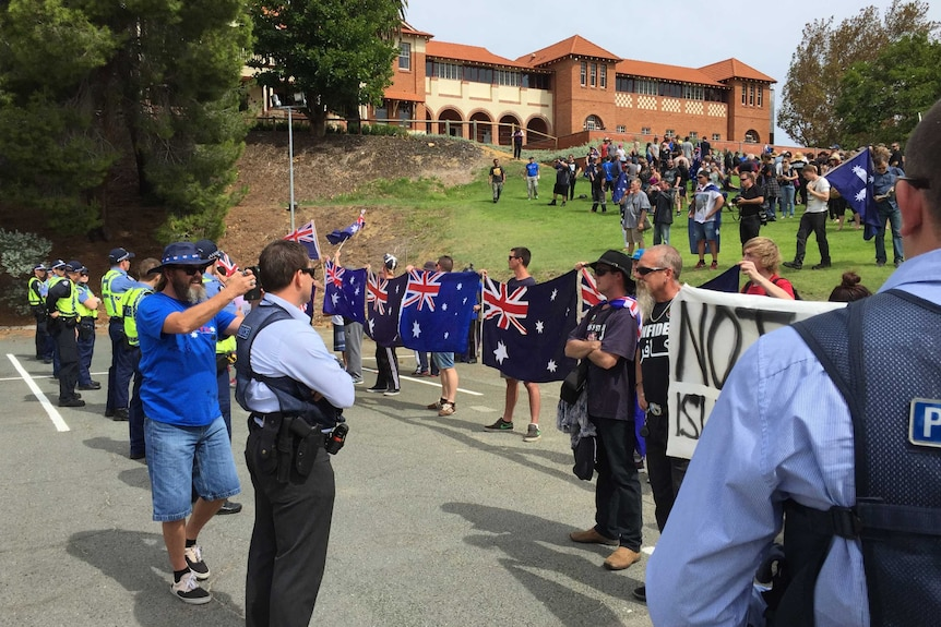 Police separate protesters from opposing groups in Perth