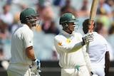 Usman Khawaja celebrates a half-century